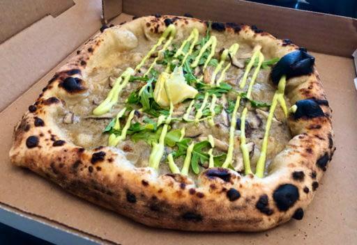 A close-up shot of pizza.