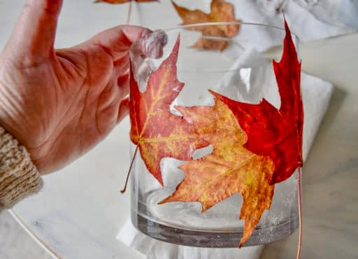 leaves on a candle holder